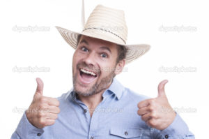 Silly bearded Caucasian man wearing Mexican sombrero gives a double thumbs up and big smile on white background